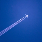 Airplane with jet trail